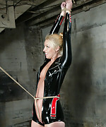 Latex blonde roped and suspended