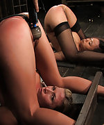 Two girls put in stocks, anally plugged and made to cum