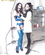 Latex brunette ring-gagged and trained