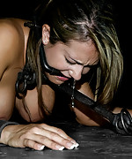 Trina gets stapled to the floor for hot wax fun