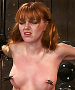 Cute redhead bound and brutally fucked by a machine