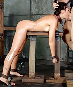 Busty brunette chained, shackled, fucked