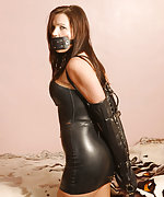 Sexy tight black latex dress, cuffs and gag