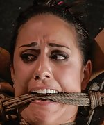 Pretty brunette cums in rope bondage