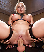 Busty blond gets fucked in tight bondage