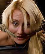 Mallory restrained in unforgiving bamboo bondage