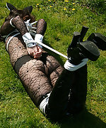 Pretty brunette gets roped and hogtied outdoors