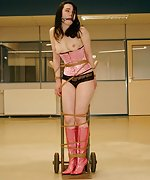 Sexy brunette helplessly roped for doll delivery