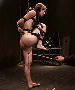Petite brunette bound tight, caned hard