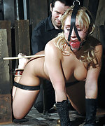 Cuffed, tightly gagged, caned, pegged, clamped