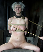 Very tightly roped and forced to sit on the wooden horse