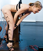 Tied up in precarious bondage, pegged, clamped, plugged