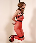 Milf in fishnet body suit bound and hanging