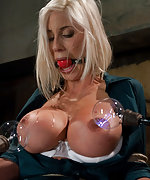 Busty blonde tied & examined by two femdoms