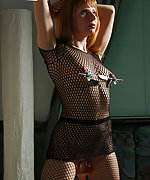 Fishnet, ropes, clampes and dildo