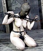 Shackled, hobbled, dildoed and iron masked