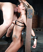 Shackled to sybian in breast bondage and facefucked