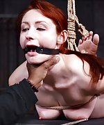 Redhead gets roped, whipped, hogtied, used