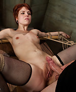 Redhead gets roped, pegged and fucked