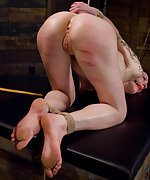 Nina gets roped, pegged, caned and strapon fucked
