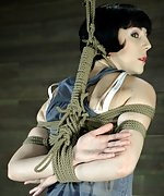 Fit model in tight, restricting rope bondage